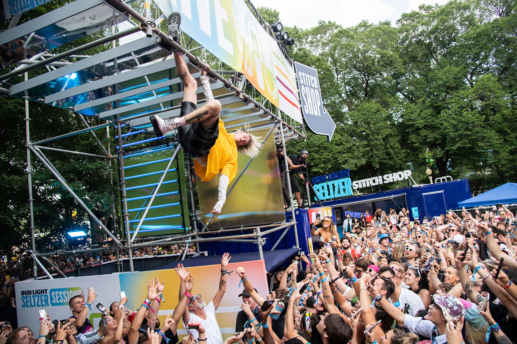 Machine Gun Kelly performs a surprise set on the Bud Light Seltzer Sessions stage on day three of the Lollapalooza Music Festival on Saturday, July 31, 2021, at Grant Park in Chicago. (Photo by Amy Harris/Invision/AP)