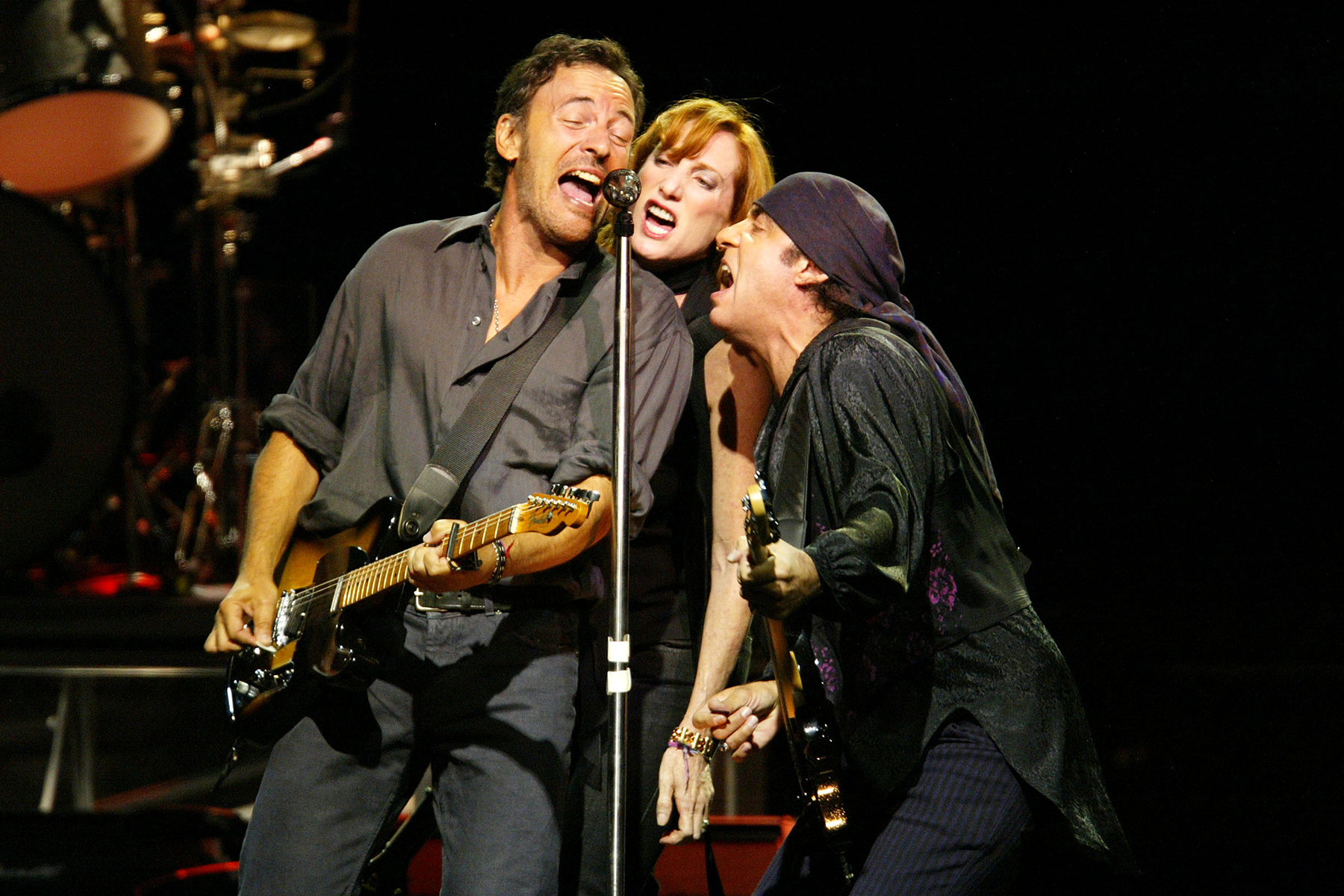 """Bruce Springsteen, Patty Scialfa, and Steven Van Zandt perform during the first show of the """"Bruce Springsteen & the E Street Band"""" tour at the Continental Airlines Arena in East Rutherford, New Jersey, August 7, 2002. Photo by Frank Micelotta/ImageDirect."""