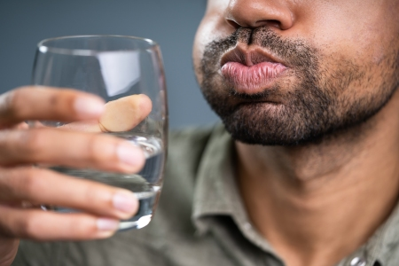 Close-up Of Man Rinsing And Gargling