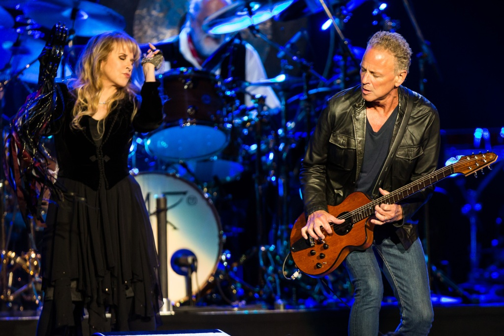 LOS ANGELES, CA - JULY 03: Vocalist Stevie Nicks (L) and vocalist/guitarist Lindsey Buckingham of Fleetwood Mac perform at Staples Center on July 3, 2013 in Los Angeles, California. (Photo by Chelsea Lauren/WireImage)