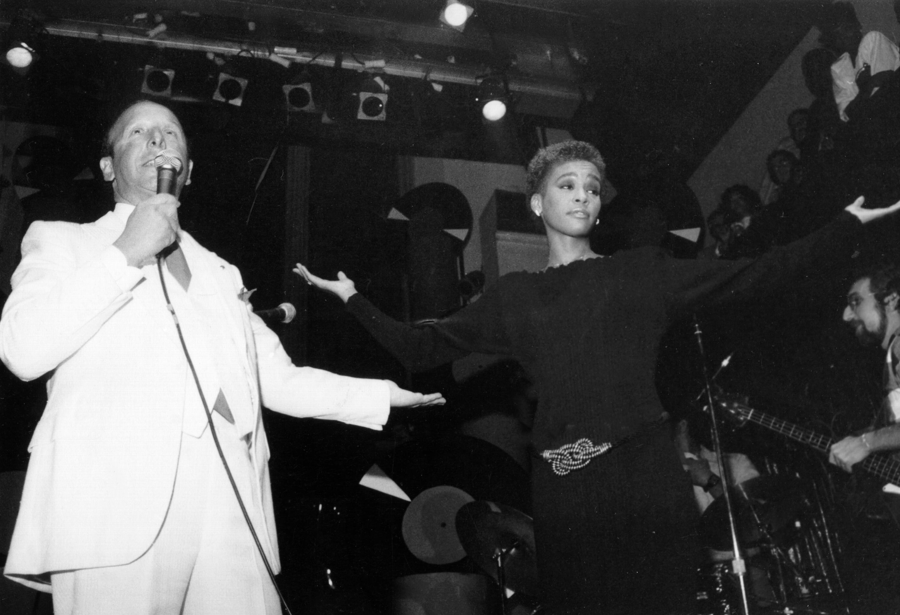 NEW YORK - 1984: Music executive Clive Davis introduces pop singer Whitney Houston in 1984 in New York, New York. (Photo by Michael Ochs Archives/Getty Images)