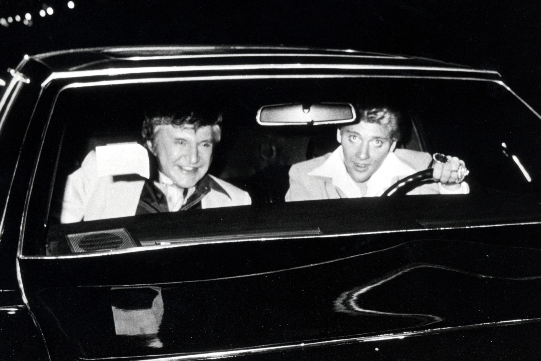 Liberace and Scott Thorson at La Cage Aux Folles in Hollywood on April 21, 1981 in Hollywood, California