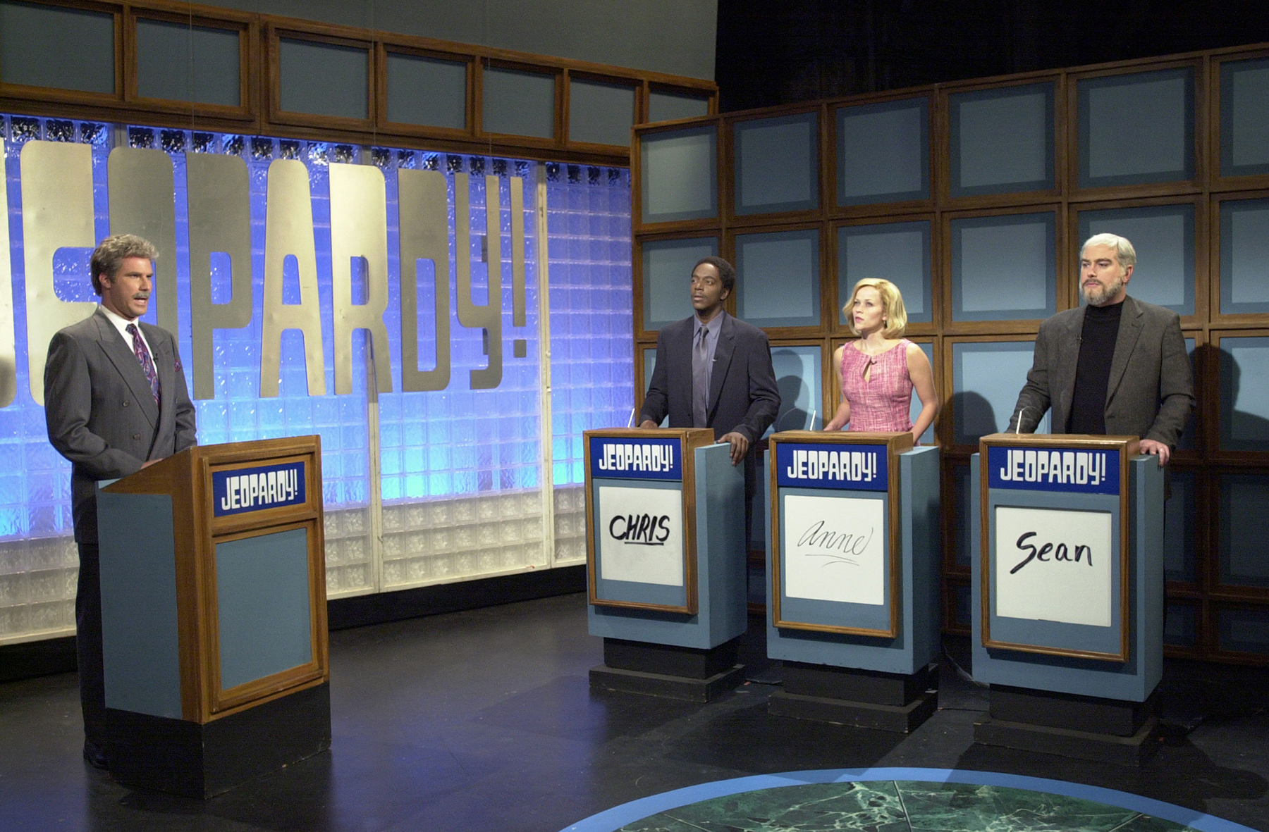"""SATURDAY NIGHT LIVE -- Episode 1 -- Air Date 09/29/2001 -- Pictured: (l-r) Will Ferrell as Alex Trebek, Dean Edwards as Chris Tucker, Reese Witherspoon as Anne Heche, Darrell Hammond as Sean Connery during the """"Jeopardy!"""" skit on September 29, 2001 -- Photo by: Dana Edelson/NBCU Photo Bank"""