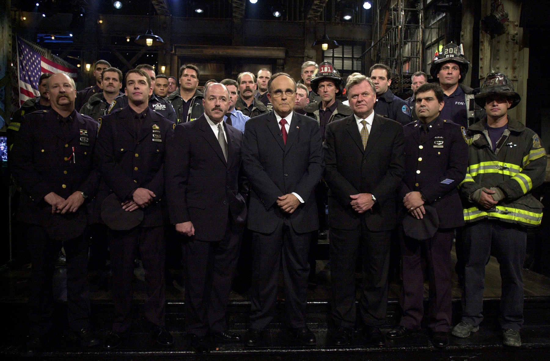"""SATURDAY NIGHT LIVE -- Episode 1 -- Air Date 09/29/2001 -- Pictured: Members of ththe New York Fire Department, New York Police Department, Port Authority Police Department, with (center, l-r) Police Commissioner Bernard Kerik, Mayor Rudolph Guiliani, Fire Commissioner Tom Von Essen during the """"9/11 Tribute"""" on September 29, 2001 -- Photo by: Dana Edelson/NBCU Photo Bank"""