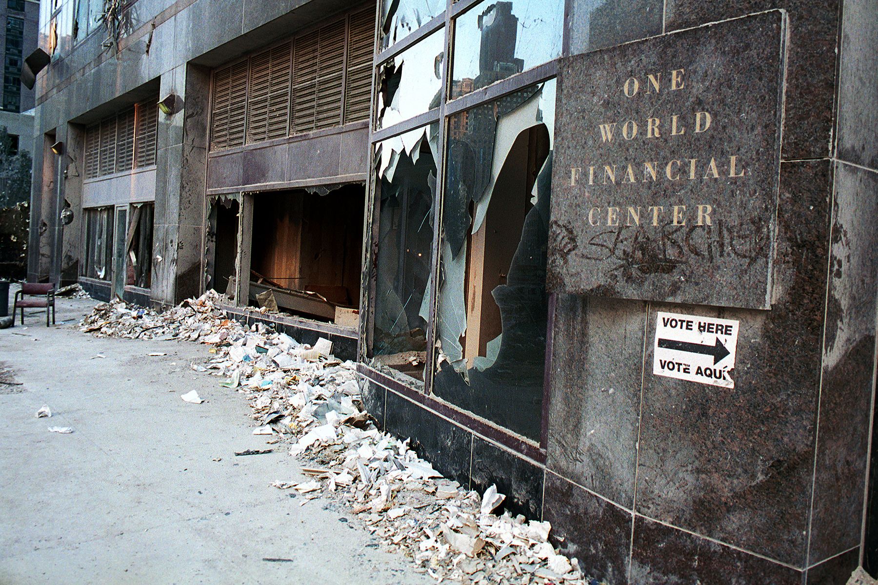 """394375 18: The destroyed front of One World Financial Center sports a """"Vote Here"""" sign across from the site of the World Trade Center September 13, 2001 in New York City, two days after the twin towers were destroyed when hit by two hijacked passenger jets. (Photo by Chris Hondros/Getty Images)"""