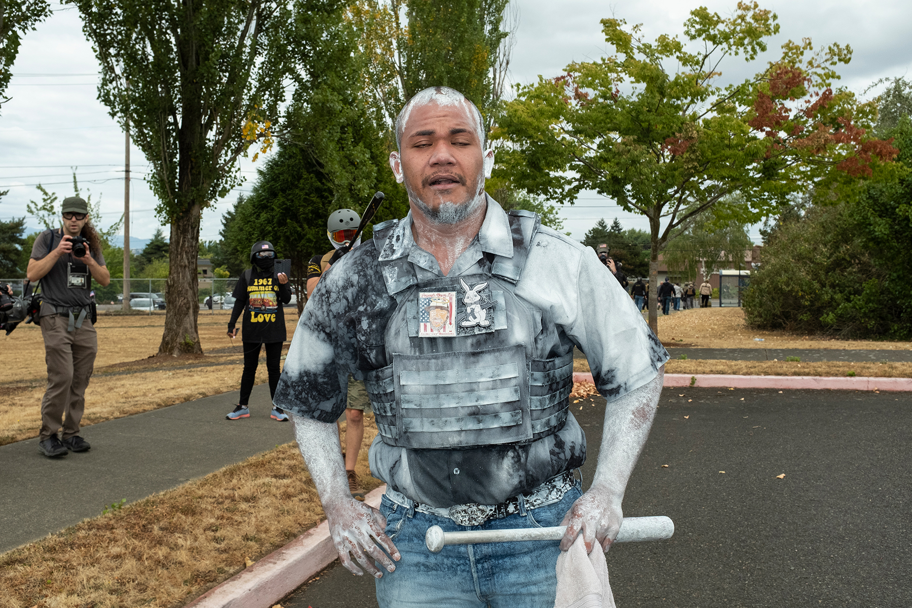 """Far-right activist Tusitala """"Tiny"""" Toese recovers from a battle with antifascist counter-protesters at a Proud Boys rally in Portland, Ore., August 22, 2021."""