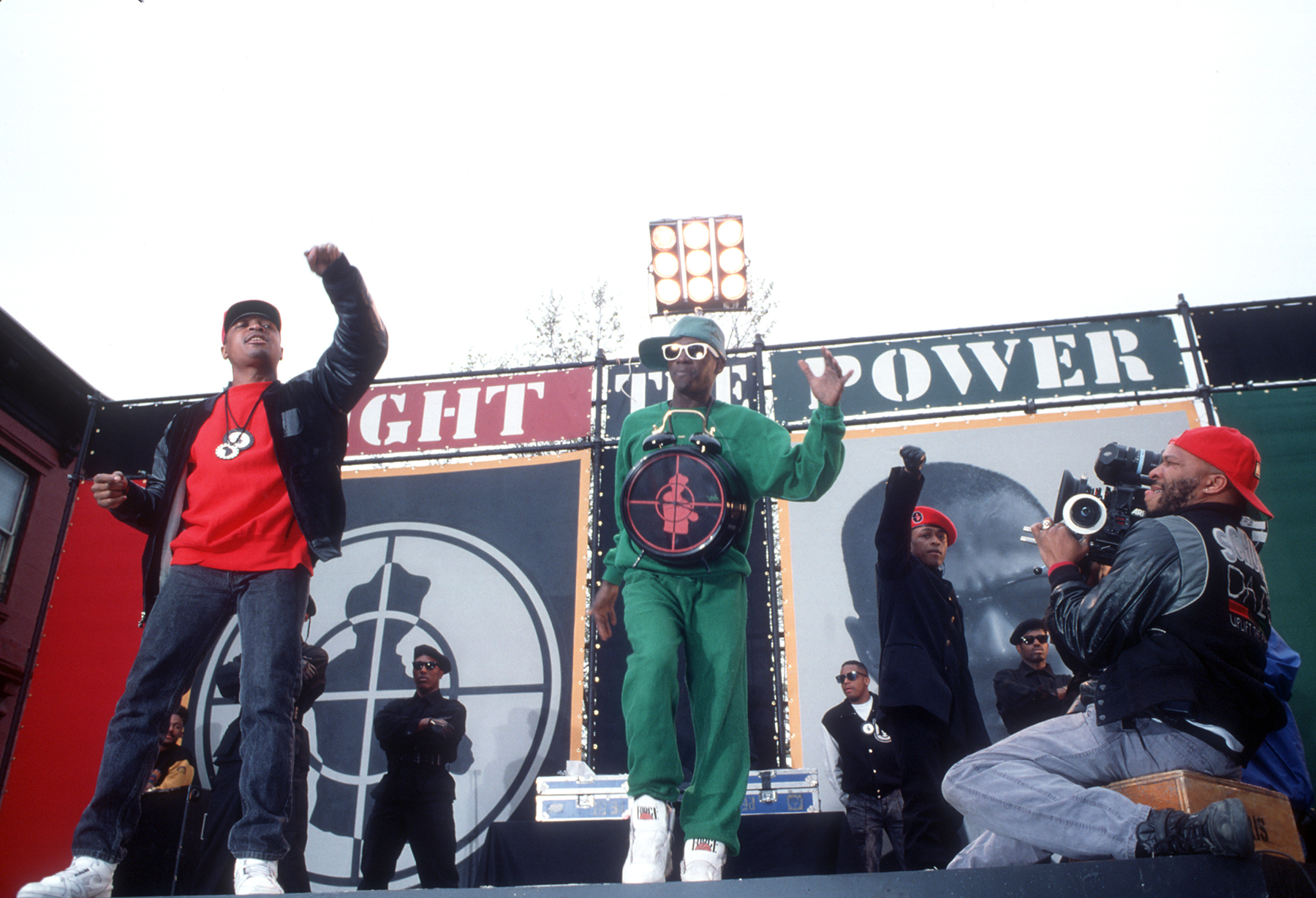 NEW YORK - 1989: (L-R) Rapper Flavor Flav, director Spike Lee and Chuck D of the rap group 'Public Enemy' film a video for their song 'Fight The Power' directed by Spike Lee in 1989 in New York, New York. (Photo by Michael Ochs Archives/Getty Images)