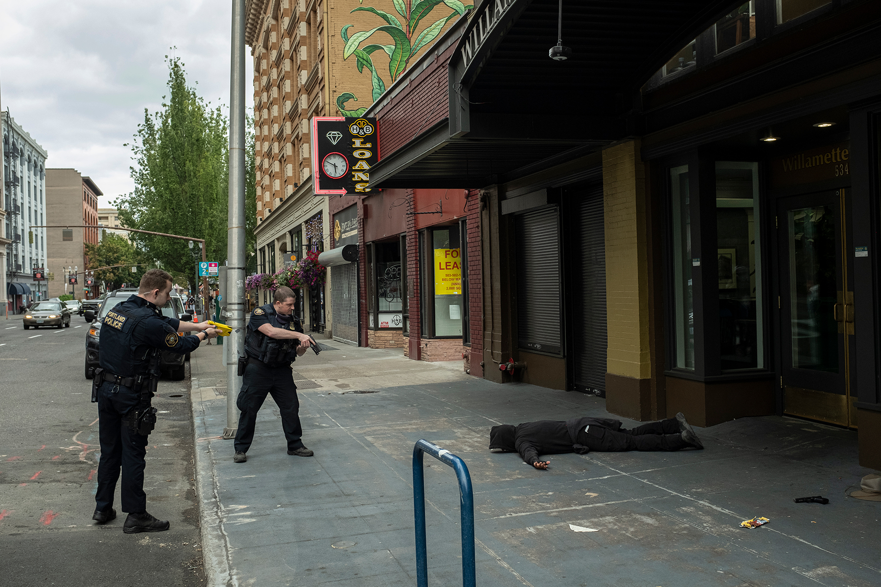Police disarm and arrest Dennis G. Anderson after he engaged in a gunfight with antifascist activists in Portland, Ore., August 22, 2021. He was charged with unlawful use of a weapon and unlawful possession of a firearm.