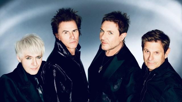 Duran Duran Rage With Queen Elizabeth, Lady Gaga Lookalikes in New 'Anniversary' Video.jpg