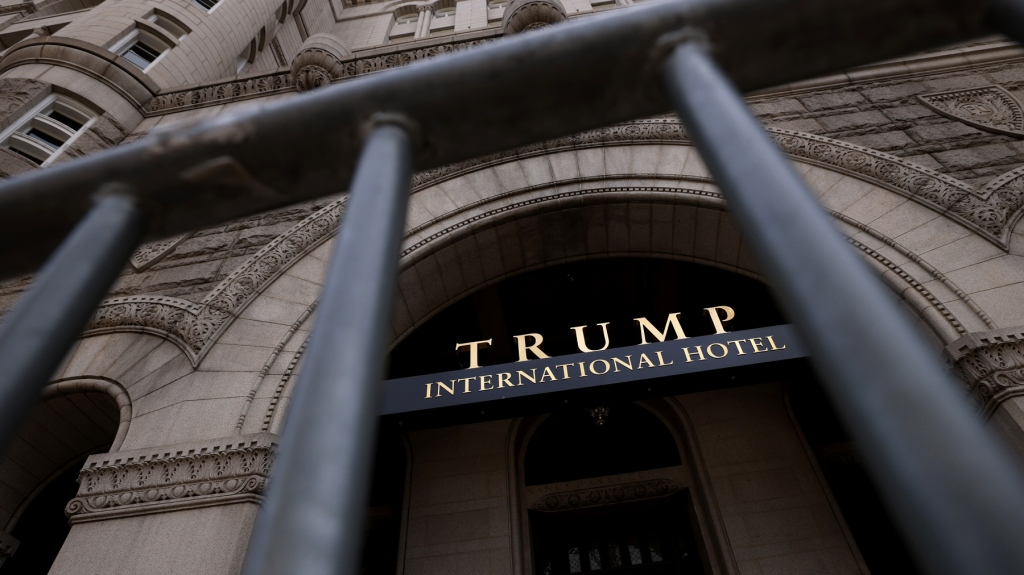 The Trump International Hotel is seen though security fencing on June 02, 2021 in Washington, DC.