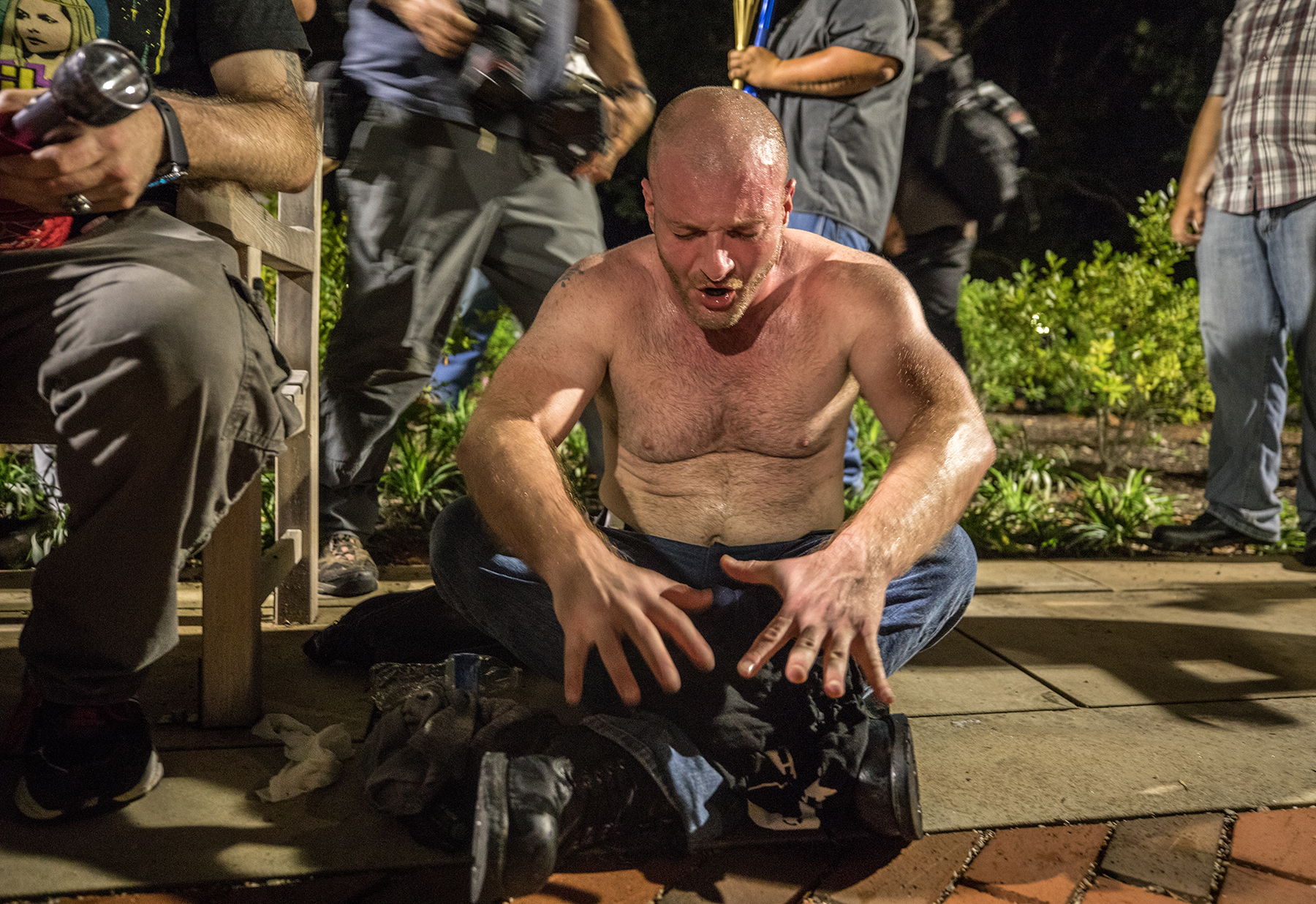 CHARLOTTESVILLE,VA-AUG11: Updated with name -- Christopher Cantwell, 36-year-old leader in the white supremacist movement.A white nationalist is helped by police after being overcome with tear gas after hundreds of white nationalists and white supremacists carrying torches marched in a parade through the University of Virginia campus. Beginning a little after 9:30 p.m., the march lasted 15 to 20 minutes before ending in skirmishing when the marchers were met by a small group of counterprotesters at the base of a statue of Thomas Jefferson, the universitys founder. (Photo by Evelyn Hockstein/For The Washington Post via Getty Images)