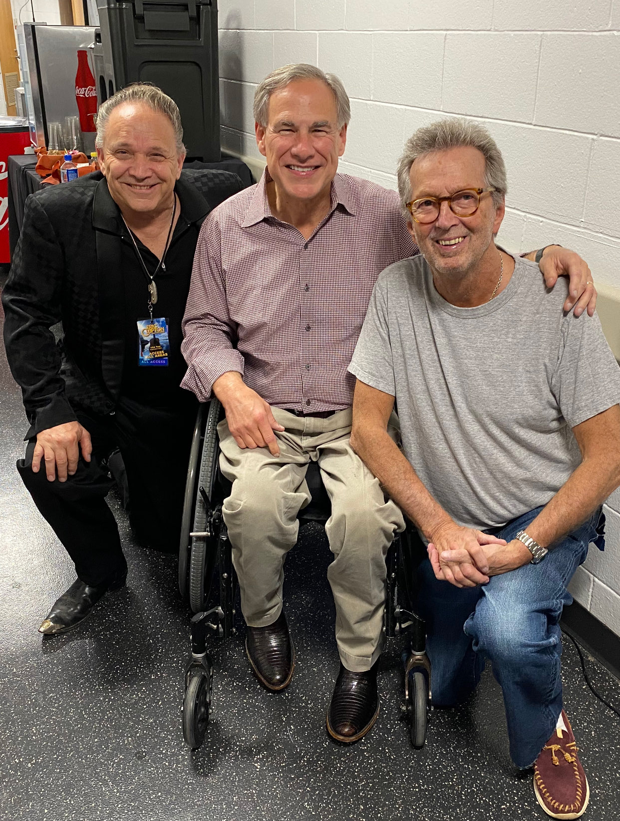 Texas Gov. Greg Abbott (middle), known for his attacks on abortion and voting rights, attended Clapton's recent Austin show.