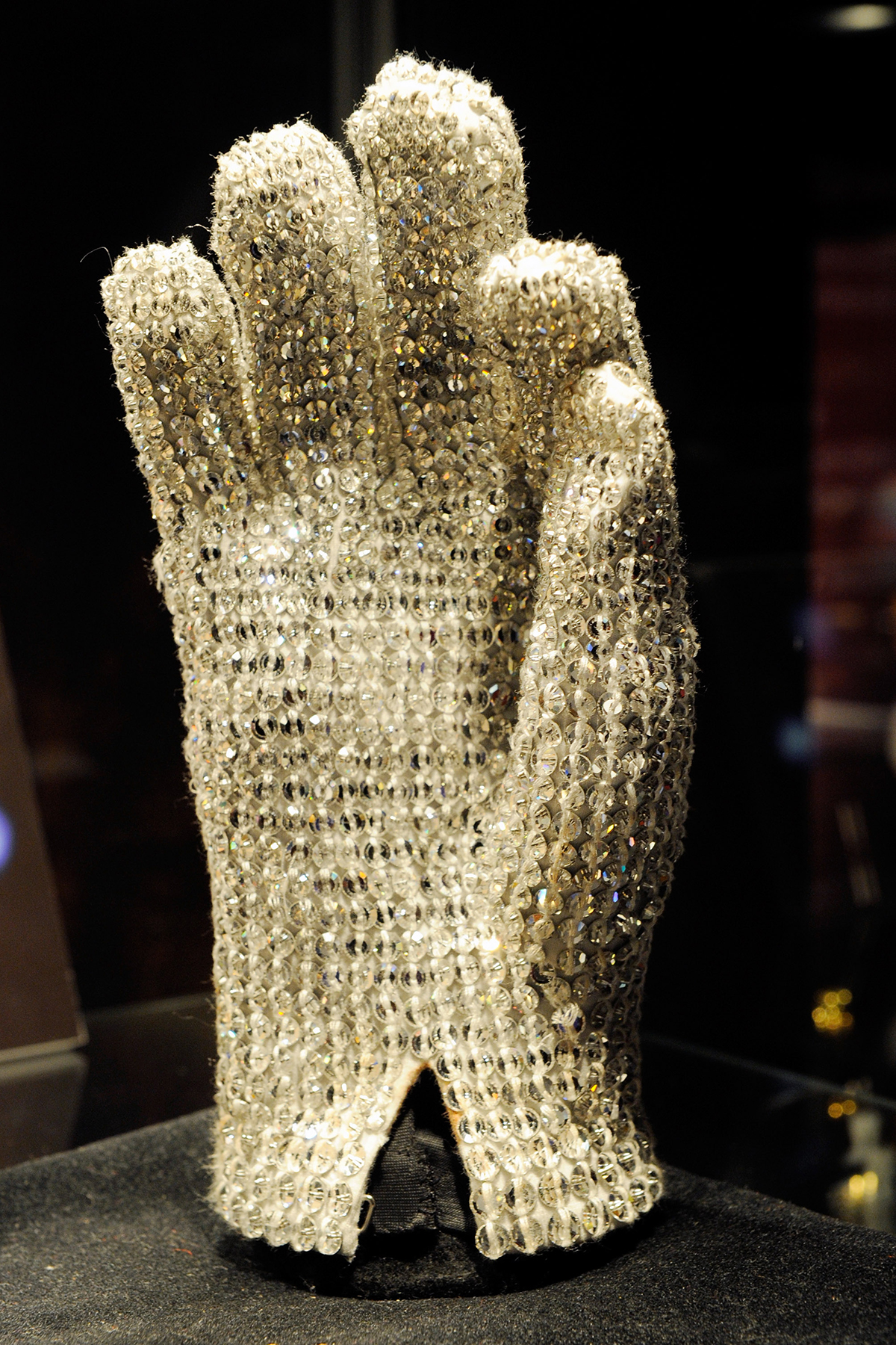 LAS VEGAS - JUNE 24: A Michael Jackson Victory Tour glove covered in clear Swarovski crystals is displayed at Julien's Auctions annual summer sale at the Planet Hollywood Resort & Casino June 24, 2010 in Las Vegas, Nevada. The auction, which continues through Sunday, features 1,600 items from entertainers including Michael Jackson, Anna Nicole Smith, Star Trek creator Gene Roddenberry, Marilyn Monroe, Cher and Elvis Presley. (Photo by Ethan Miller/Getty Images)
